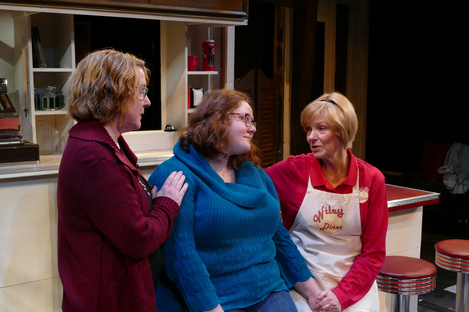 Lisa L Wiley as Kate Myers, Michelle Deyarmin as Lily Flores and Anne McEvoy as Sheila Banks